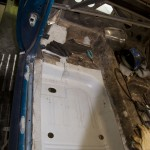 Floor pan clamping in place